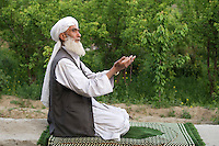 Muslim man in afternoon prayers.
