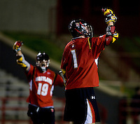 Grant Catalino (1) of Maryland celebrates his goal with teammate Joe Cummings (19) during the ACC men's lacrosse tournament semifinals in College Park, MD.  Maryland defeated North Carolina, 13-5.