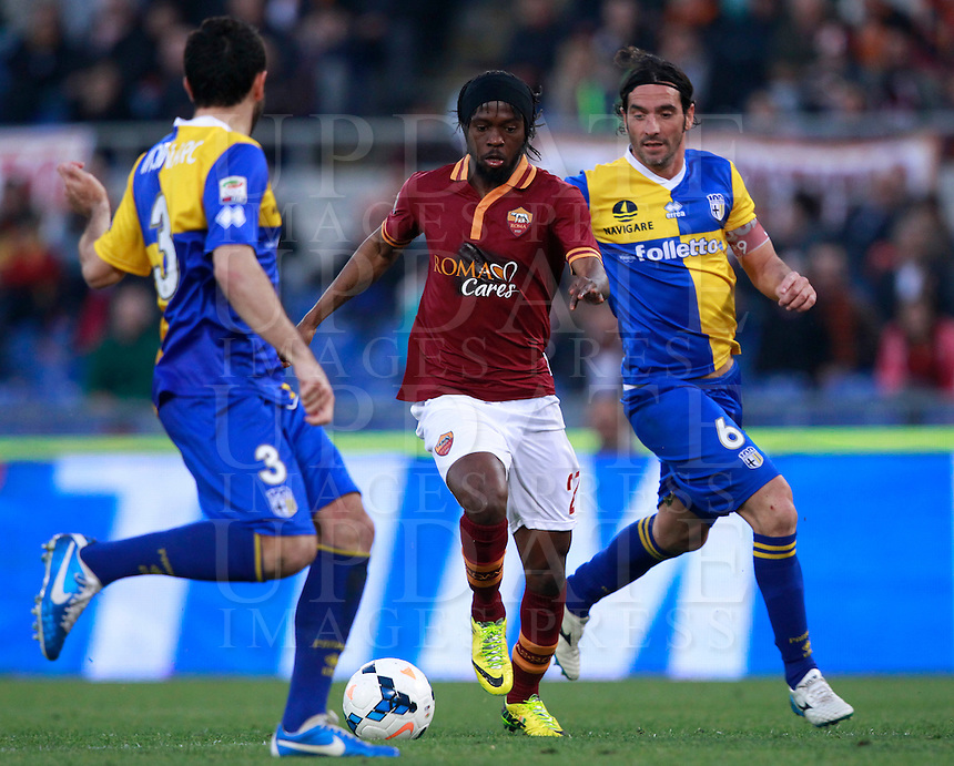 Calcio, Serie A: Roma vs Parma. Roma, stadio Olimpico, 2 aprile 2014.<br /> AS Roma forward Gervinho, of Ivory Coast, center, is challenged by Parma defenders Cristian Molinaro, left, and Alessandro Lucarelli during the Italian Serie A football match between AS Roma and Parma at Rome's Olympic stadium, 2 April 2014.<br /> UPDATE IMAGES PRESS/Isabella Bonotto