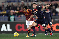 Calcio, Serie A: Roma vs Cagliari. Roma, stadio Olimpico, 1 febbraio 2013..AS Roma defender Dodo', of Brazil, left, and Cagliari midfielder Albin Ekdal, of Sweden, fight for the ball during the Italian Serie A football match between AS Roma and Cagliari, at Rome's Olympic stadium, 1 February 2013..UPDATE IMAGES PRESS/Isabella Bonotto