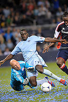 C.J Sapong (17) sporting KC forward attempts to go around New England goalkeeper Matt Reis... Sporting Kansas City defeated New England Revolution 3-0 at LIVESTRONG Sporting Park, Kansas City, Kansas.