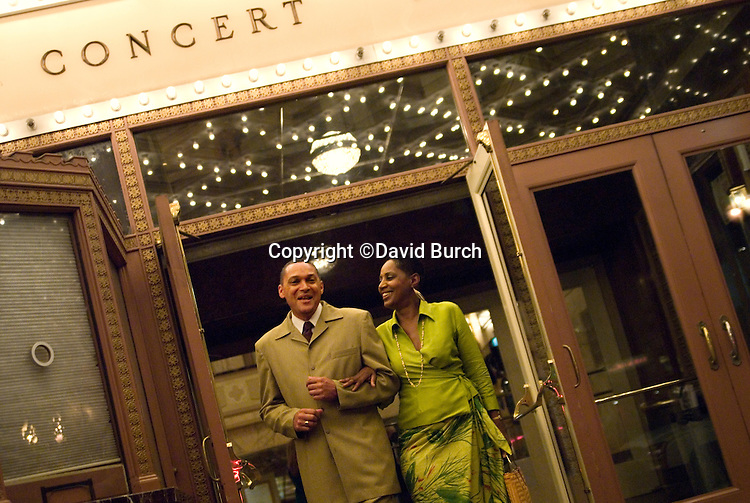 African American couple leaving concert hall