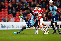 Adebayo Akinfenwa of Wycombe Wanderers (left)during the Sky Bet League 2 match between Doncaster Rovers and Wycombe Wanderers at the Keepmoat Stadium, Doncaster, England on 29 October 2016. Photo by David Horn.