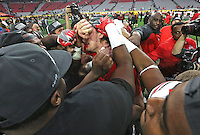A tearful Ohio State Buckeyes defensive lineman Joey Bosa (97) is surrounded by his teammates after returning to the field at the conclusion of the Fiesta Bowl at University of Phoenix Stadium in Glendale, AZ on January 1, 2016.  They beat Notre Dame 44-28.   (Chris Russell/Dispatch Photo)