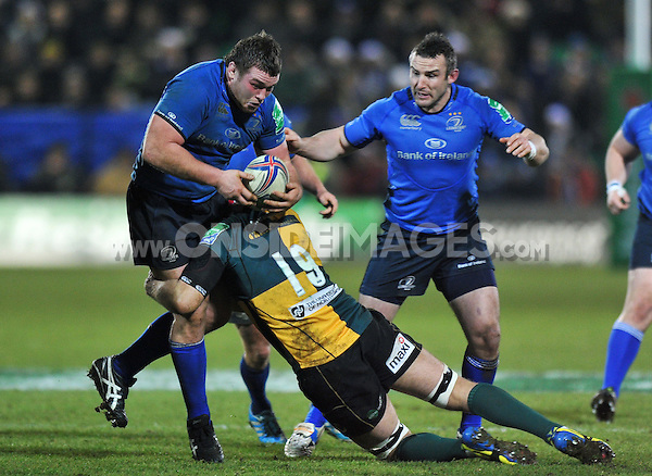 Jack McGrath is tackled by Christian Day. Heineken Cup match, between Northampton Saints and Leinster on December 7, 2013 at Franklin's Gardens in Northampton, England. Photo by: Patrick Khachfe / JMP