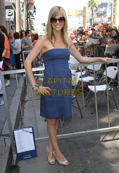 Kaitlin Olson.Danny DeVito Honored On The Hollywood Walk Of Fame Held On Hollywood Blvd., Hollywood, California, USA..August 18th, 2011.full length blue strapless dress hand on hip sunglasses shades  .CAP/ADM/KB.©Kevan Brooks/AdMedia/Capital Pictures.