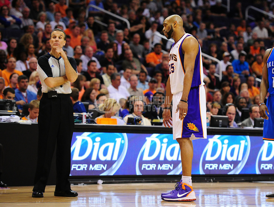 Mar. 30, 2011; Phoenix, AZ, USA; Phoenix Suns guard (25) Vince Carter argues with referee Ken Mauer against the Oklahoma City Thunder at the US Airways Center. Mandatory Credit: Mark J. Rebilas-.