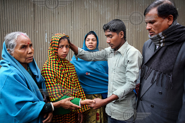 The moderators of the Shalish settling Arjina Begum's (25) complaint of domestic violence against her husband Iliash Miah (27). Shalish is a social system for informal adjudication of petty disputes.