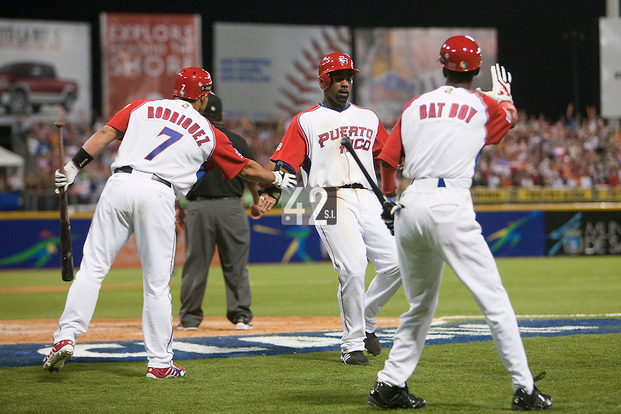 11 March 2009: #21 Carlos Delgado of Puerto Rico celebrates with Ivan Rodriguez as he scores during the 2009 World Baseball Classic Pool D game 6 at Hiram Bithorn Stadium in San Juan, Puerto Rico. Puerto Rico wins 5-0 over the Netherlands