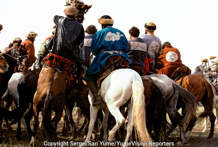 "A Buzkashi between North East Afghans in the National stadium of Kabul..""bOzkashI"" is one of the ancient games played in Afghanistan. The name of this game is perhaps derived from hunting mountain goats by ancient champions n horseback."
