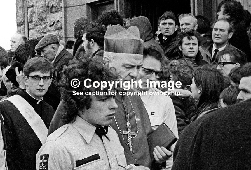 Cardinal Willian Conway, head, Roman Catholic Church in Ireland arrives St Mary's Church, Creggan, Londonderry to take part in the Mass for 11 of the 13 Bloody Sunday victims. The funerals of the other two victims took place in the Waterside and in Donegal. 197202020069g, 69/72<br /> <br /> Copyright Image from Victor Patterson, 54 Dorchester Park, Belfast, UK, BT9 6RJ<br /> <br /> t1: +44 28 9066 1296 (from Rep of Ireland 048 9066 1296)<br /> t2: +44 28 9002 2446 (from Rep of Ireland 048 9002 2446)<br /> m: +44 7802 353836<br /> <br /> e1: victorpatterson@me.com<br /> e2: victorpatterson@gmail.com<br /> <br /> www.victorpatterson.com<br /> <br /> IMPORTANT: Please see my Terms and Conditions of Use at www.victorpatterson.com