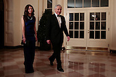 Chuck Hagel, U.S. Secretary of defense, right, and Allyn Hagel arrive to a state dinner hosted by U.S. President Barack Obama and U.S. First Lady Michelle Obama in honor of French President Francois Hollande at the White House in Washington, D.C., U.S., on Tuesday, Feb. 11, 2014. Obama and Hollande said the U.S. and France are embarking on a new, elevated level of cooperation as they confront global security threats in Syria and Iran, deal with climate change and expand economic cooperation. <br /> Credit: Andrew Harrer / Pool via CNP