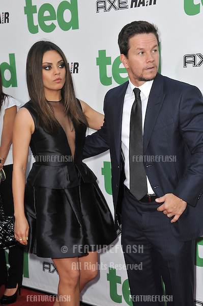 "Mila Kunis & Mark Wahlberg at the world premiere of their movie ""Ted"" at Grauman's Chinese Theatre, Hollywood..June 22, 2012  Los Angeles, CA.Picture: Paul Smith / Featureflash"