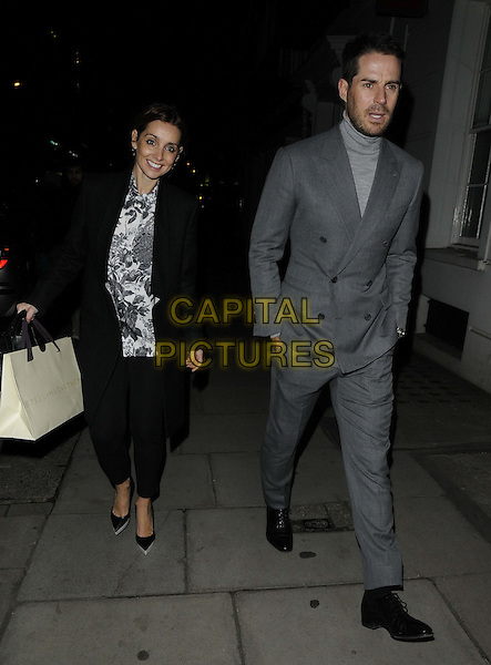 Louise Redknapp & Jamie Redknapp.The Stella McCartney boutique Christmas Lights switch on, Stella McCartney, Bruton St., London, England..December 10th, 2012.full length black coat white grey gray print top grey gray suit turtleneck top beard facial hair married husband wife .CAP/CAN.©Can Nguyen/Capital Pictures.