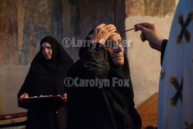 The priest anointing the forehead of a nun with oil, inside the Church of the Ascension of Jesus Christ at the Monastery Mileševa, Serbia originally built in the 13th century. Reverend Hieromonk Leontije, monastery priest