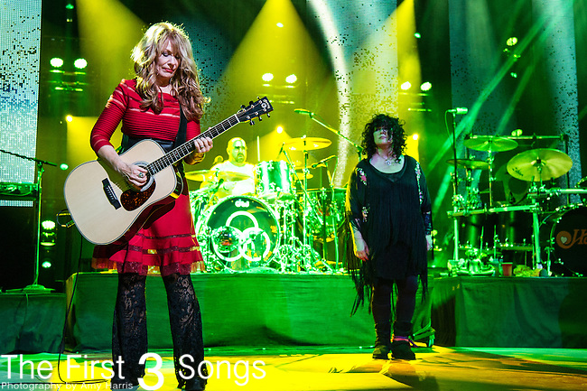 Ann Wilson and Nancy Wilson of Heart perform with Jason Bonham at Riverbend Music Center in Cincinnati, Ohio.