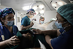 Team of American Doctors performing surgery onboard of the Rongdhonu Friendship Hospital docked outside the mongla port 29 April 2014