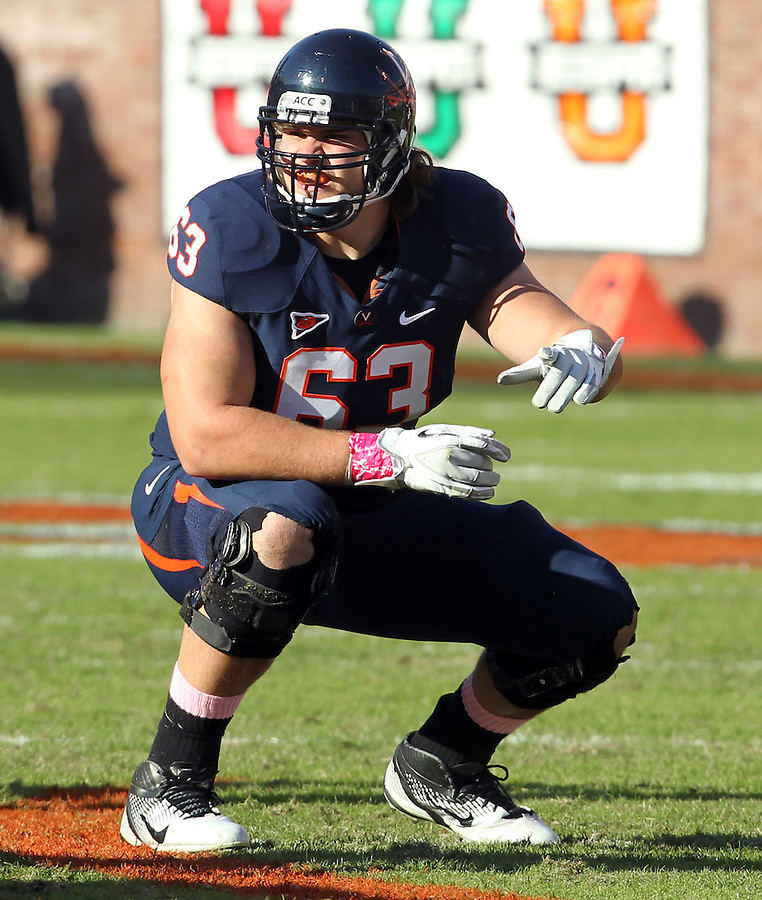 Oct. 22, 2011 - Charlottesville, Virginia - USA; Virginia Cavaliers guard Austin Pasztor (63) during an NCAA football game against the North Carolina State Wolfpack at the Scott Stadium. NC State defeated Virginia 28-14. (Credit Image: © Andrew Shurtleff/