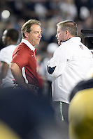 January 7, 2013: Alabama head coach Nick Saban and Notre Dame head coach Brian Kelly before the start of the Discover BCS National Championship game between the Alabama Crimson Tide and the Notre Dame Fighting Irish at Sun Life Stadium in Miami Gardens, Fl