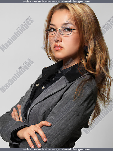 Portrait of a young attractive businesswoman. Isolated on gray background.