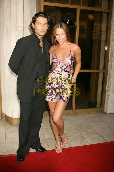 "ALEC MAZO & EDYTA SLIWINSKA.""1408"" World Premiere held at the Mann National Theater, Westwood, California, USA..June 12th, 2007.full length Dancing With The Stars black suit gold purple print satin dress .CAP/ADM/RE.©Russ Elliot/AdMedia/Capital Pictures"