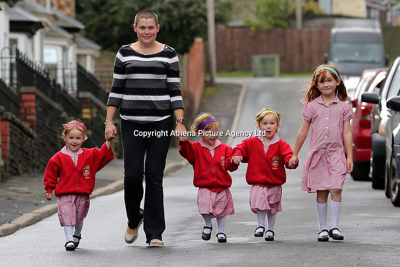 Pictured: Ffion, mum Karen, Paige, Maddison, and older sister Faye  <br /> Re: A set of identical triplets have been colour-coded to help teachers tell them apart on their first day in nursery school.<br /> Three-year-olds Ffion, Maddison and Paige Gilbert, are so alike even their parents struggle to know which is which.<br /> Karen and Ian Gilbert used different coloured nail-varnish on their fingers and toes to identify them when they were babies.<br /> Now the couple are using the same colours for their hair bands and bobbles at the nursery where they have just enrolled.<br /> And the colours even correspond with the names of the identical trio. <br /> Ffion has fuschia, Maddison has mint and Paige has purple.<br /> Karen, 35, of Pontypool, South Wales, said: &quot;We have colour-coded them since they were tiny babies - it helped us keep track of which ones had been fed.<br /> &quot;But nail varnish isn't allowed in school so we had come up with come other way.