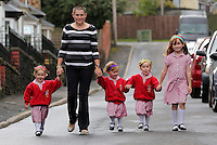 "Pictured: Ffion, mum Karen, Paige, Maddison, and older sister Faye  <br /> Re: A set of identical triplets have been colour-coded to help teachers tell them apart on their first day in nursery school.<br /> Three-year-olds Ffion, Maddison and Paige Gilbert, are so alike even their parents struggle to know which is which.<br /> Karen and Ian Gilbert used different coloured nail-varnish on their fingers and toes to identify them when they were babies.<br /> Now the couple are using the same colours for their hair bands and bobbles at the nursery where they have just enrolled.<br /> And the colours even correspond with the names of the identical trio. <br /> Ffion has fuschia, Maddison has mint and Paige has purple.<br /> Karen, 35, of Pontypool, South Wales, said: ""We have colour-coded them since they were tiny babies - it helped us keep track of which ones had been fed.<br /> ""But nail varnish isn't allowed in school so we had come up with come other way."