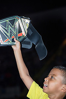 "David Lopez, Jr., 7, of Springfield, Mass., holds a replica WWE champion belt during a WWE Live Summerslam Heatwave Tour event at the MassMutual Center in Springfield, Massachusetts, USA, on Mon., Aug. 14, 2017. David Lopez (the father, not pictured) said it was his son's first wrestling match. ""I remember my dad doing this [with me],"" he said."