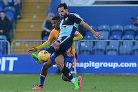 Wycombe Wanderers Sam Wood plays the ball forward under pressure from Mansfield Town's Reggie Lambe during the Sky Bet League 2 match between Mansfield Town and Wycombe Wanderers at the One Call Stadium, Mansfield, England on 31 October 2015. Photo by Garry Griffiths.