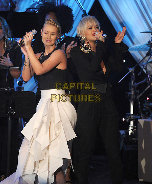 BEVERLY HILLS, CA -  FEBRUARY 7: Iggy Azalea and  Rita Ora perform on the 2015 Pre-Grammy Gala &amp; Grammy Salute to Industry Icons at the Beverly Hilton Hotel on February 7, 2015 in Beverly Hills, California. <br /> CAP/MPI/PGFM<br /> &copy;PGFM/MPI/Capital Pictures