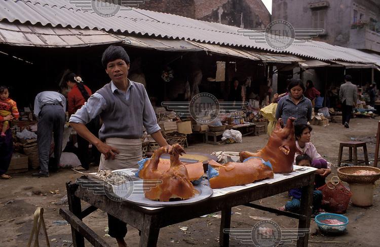 Roast pork vendor at a food market.