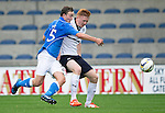 Raith Rovers v St Johnstone...12.07.14  Pre-Season Friendly<br /> Chris Kane battles with David Bates<br /> Picture by Graeme Hart.<br /> Copyright Perthshire Picture Agency<br /> Tel: 01738 623350  Mobile: 07990 594431