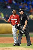 Oklahoma City RedHawks outfielder Adron Chambers (2) argues a call with umpire Spencer Flynn during a game against the Memphis Redbirds on May 23, 2014 at AutoZone Park in Memphis, Tennessee.  Oklahoma City defeated Memphis 12-10.  (Mike Janes/Four Seam Images)