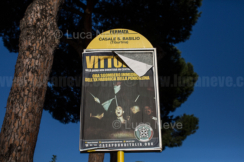 Posters by the neo-fascist group Casapound illegally covering a bus stop.<br />
