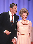 United States President Ronald Reagan and first lady Nancy Reagan hold hands on the podium of the 1988 Republican Convention as they acknowledge their supporters at the Super Dome in New Orleans, Louisiana on August 15, 1988.<br /> Credit: Arnie Sachs / CNP