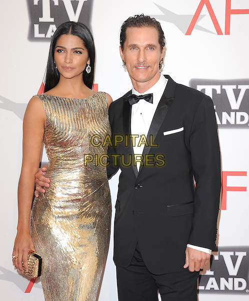 Camila Alves and Matthew McConaughey .at TV Land's 2011 AFI Lifetime AChievement Award Honoring Morgan Freeman held at Sony Picture Studios in Culver City, California, USA, .June 9th 2011..half length gold sequined sequin  dress shiny metallic couple black tuxedo tux bow tie clutch bag arm around                                                                       .CAP/RKE/DVS.©DVS/RockinExposures/Capital Pictures.