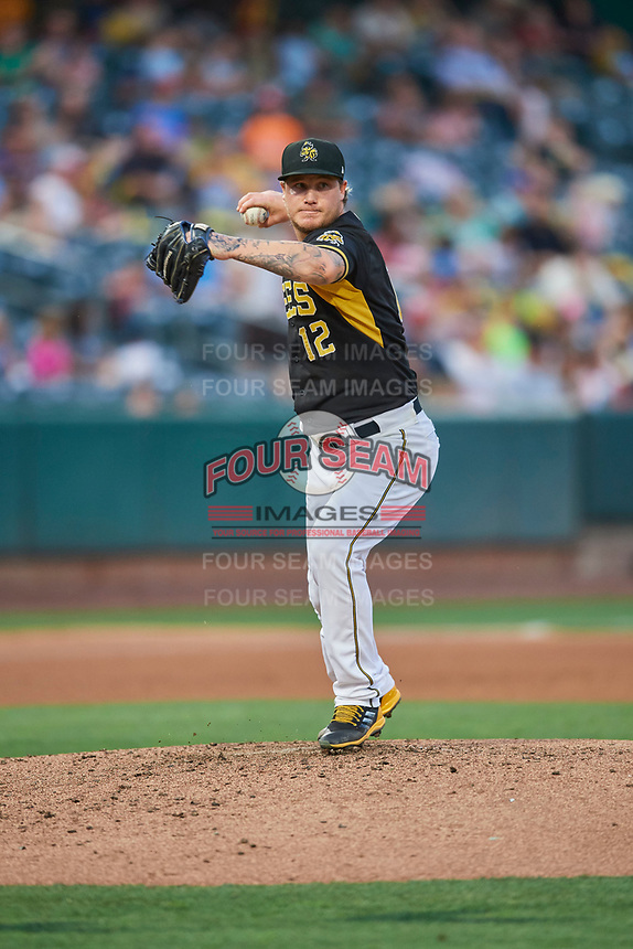 Salt Lake Bees starting pitcher Dylan Unsworth (12) throws to first base against the El Paso Chihuahuas at Smith's Ballpark on August 14, 2018 in Salt Lake City, Utah. El Paso defeated Salt Lake 6-3. (Stephen Smith/Four Seam Images)