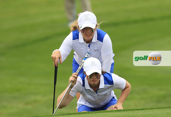 Leona Maguire and Bronte Law on the 7th green during the Friday afternoon Fourballs of the 2016 Curtis Cup at Dun Laoghaire Golf Club on Friday 10th June 2016.<br /> Picture:  Golffile | Thos Caffrey