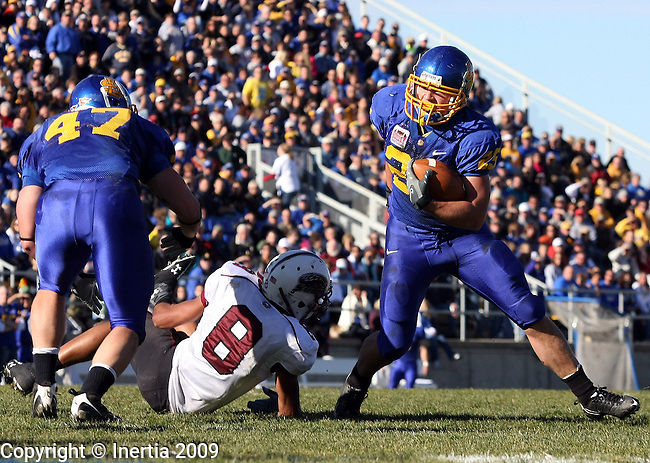 BROOKINGS, SD - NOVEMBER 7:  Tyler Duffy #25 of South Dakota State University gets tripped up by Marty Rodgers #8 of Southern Illinois inside the 5-yard line in the second quarter of their Missouri Valley Conference game Saturday afternoon at Coughlin Alumni Stadium in Brookings. (Photo by Dave Eggen/Inertia).