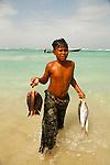 .Young boy with fishes in Qalantsiya. Socotra. Yemen
