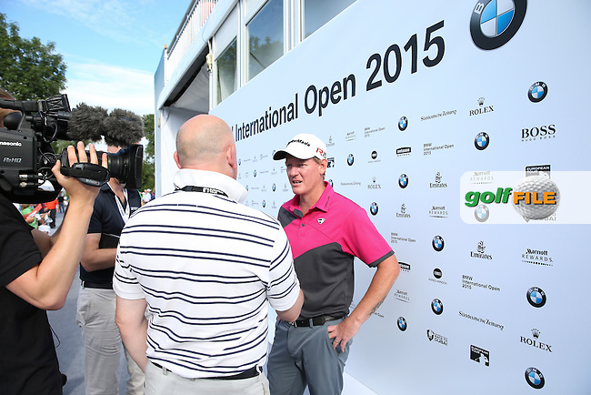 Media interview as Daniel Gaunt (ENG) and caddie John Roberts end their round with a share of the leaderboard during Round One of the 2015 BMW International Open at Golfclub Munchen Eichenried, Eichenried, Munich, Germany. 25/06/2015. Picture David Lloyd | www.golffile.ie