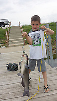 Courtesy photo<br />Owen Michael Young shows his big catfish caught while fishing with his grandpa, Barney Kunkel of Bella Vista. Kunkel wrote about their adventure to win the 2018 Northwest Arkansas Democrat-Gazette fish story contest.