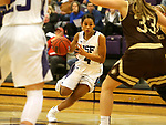 SIOUX FALLS, SD - NOVEMBER 25: Jasmine Harris #4 from the University of Sioux Falls drives against Southwest Minnesota State University during their game Saturday evening at the Stewart Center in Sioux Falls. (Photo by Dave Eggen/Inertia)