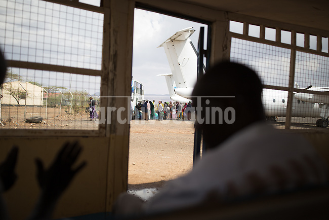 Refugees are relocated in airplanes  in   Kakuma, Kenya.Kakuma refugee camp in North of Kenya. Kakuma is the site of a UNHCR refugee camp, established in 1991. The population of Kakuma town was 60,000 in 2014, having grown from around 8,000 in 1990. In 1991, the camp was established to host the 12,000 unaccompanied minors who had fled the war in Sudan and came walking from camps in Ethiopia.