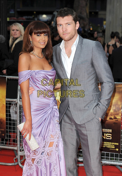 "NATALIE MARK & SAM WORTHINGTON.The World Premiere of ""Clash Of The Titans"", Empire Leicester Square, London, England..29th March 2010.half length stubble facial hair fringe couple lilac purple off the shoulders 3/4 strapless grey gray suit white shirt dress silk satin ruched arm around hand in pocket clutch bag lace cut out silver sparkly.CAP/BEL.©Tom Belcher/Capital Pictures."