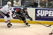 February 24th 2008:  Steve Kelly (11) of the Houston Aeros controls the puck as he's back checked by Mike Funk during a game vs. the Rochester Amerks at Blue Cross Arena at the War Memorial in Rochester, NY.  The Aeros defeated the Amerks 4-0.   Mike Janes Photography