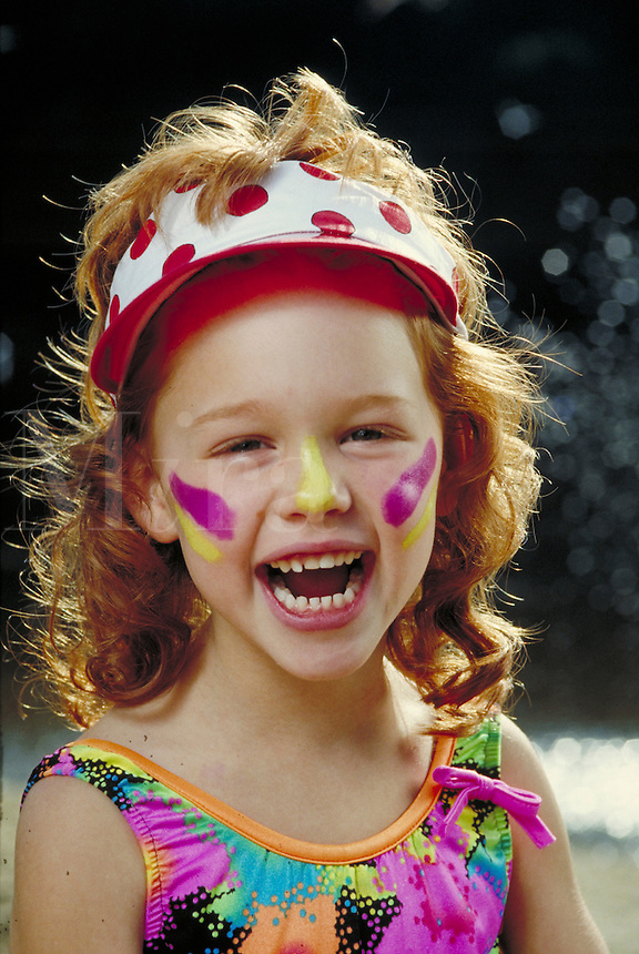 GIRL WITH SUNSCREEN LAUGHING. CAUCASIAN GIRL WEARING ZINC OXIDE SUNBLOCK. SAN FRANCISCO CALIFORNIA USA.