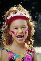 GIRL WITH SUNSCREEN LAUGHING. CAUCASIAN GIRL WEARING ZINC OXIDE SUNBLOCK. SAN FRANCISCO CALIFORNIA USA.