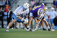 Baltimore, MD - April 5: Midfielder Mike Poppleton #29 of the John Hopkins Blue Jays and Midfielder Keith Olson # 26 of the Albany Great Dane's fight for a loose ball after the face off  during the Albany v Johns Hopkins mens lacrosse game at  Homewood Field on April 5, 2012 in Baltimore, MD. (Ryan Lasek/Eclipse Sportwire)