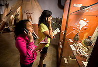 NWA Democrat-Gazette/JASON IVESTER <br /> Cindy Moreno (left) and Itzel (cq) Flores look over artifacts on display on Wednesday, Sept. 30, 2015, inside the Museum of Native American History in Bentonville. The girls, along with other fifth-graders from Westood Elementary School in Springdale, were visiting the museum as part of the Magical History Tour which also included tours of the Peel Mansion Museum and Walmart Museum.